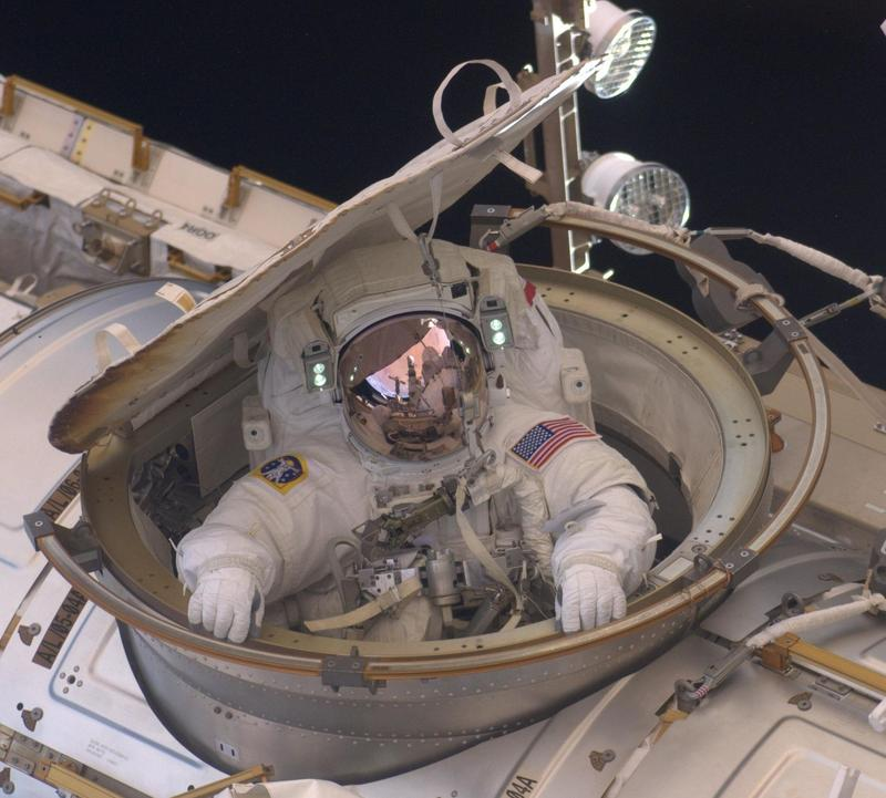 Image shows astronaut Andrew Feustel re-entering the International Space Station.