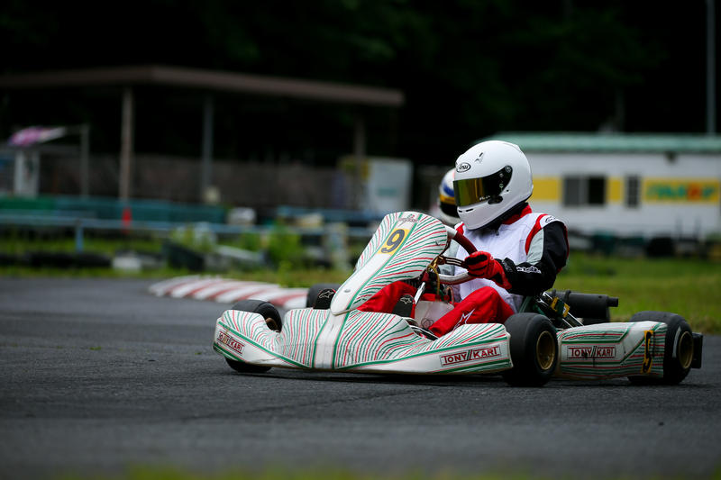 Person driving a go-kart.