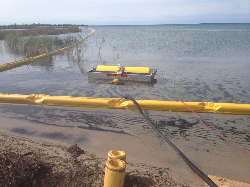 Oil booms placed near shore during spill response drill in the Straits of Mackinac.