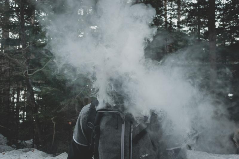 Person blowing vape cloud