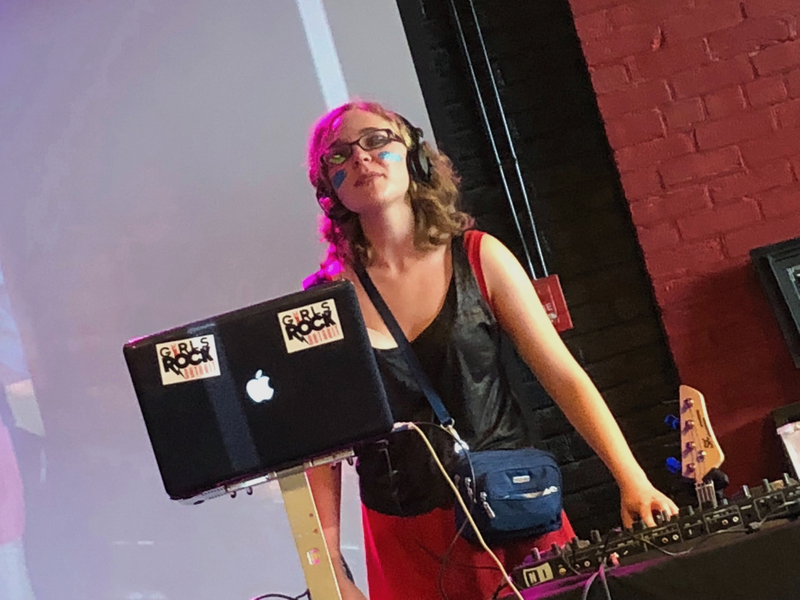 Maddie in front of a music stand on stage
