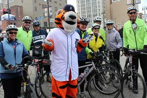 The Tigers' mascot, Paws, with cyclists who rode to Opening Day 2012.