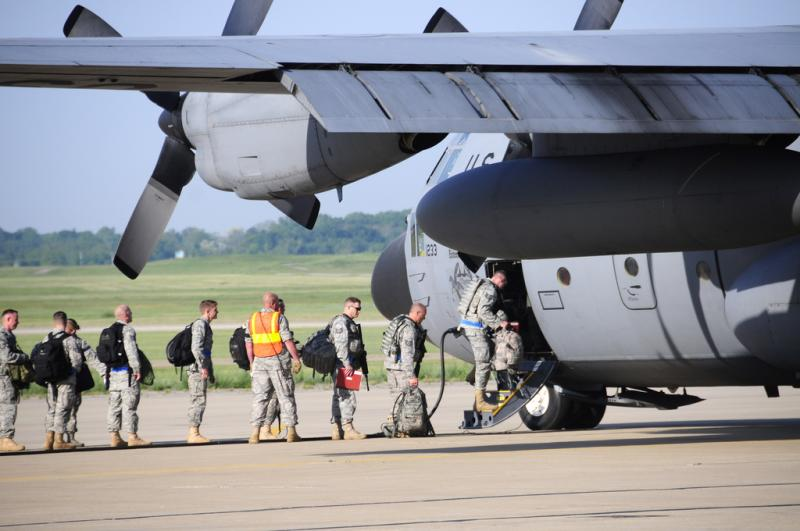 U.S. Air Force personnel from 110th Air Lift Wing boarding a C-130 prior to their departure in support of the Operation Readiness Training, Air National Guard base, Battle Creek, Mich., June 6, 2011.