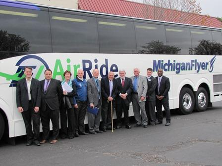 Congressman John Dingell (fifth from right) poses with those behind the AirRide public-private partnership