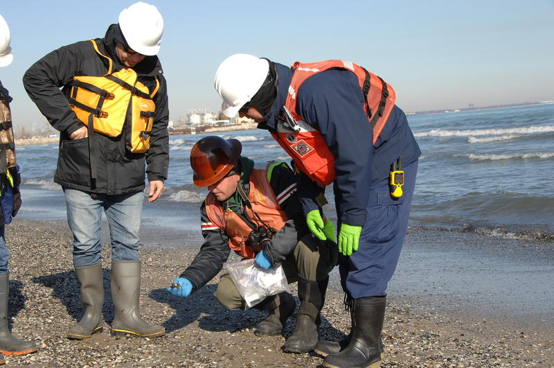 Officials from the Coast Guard, the EPA, and BP take samples near the BP Whiting Refinery on March 30, 2014.