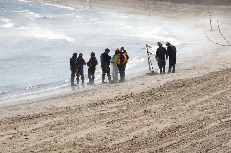 A shoreline assessment team made up of representatives from the Coast Guard, the Environmental Protection Agency and BP surveys a beach area near the BP Whiting Refinery in Whiting, Ind., March 30, 2014.