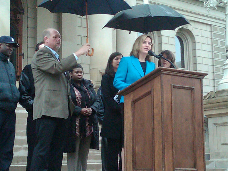 Jocelyn Benson announcing the launch of a ballot campaign to require corporations to disclose their political spending on the steps of the state Capitol in Lansing.