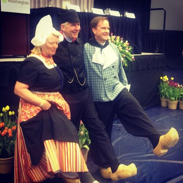 Secretary of State Ruth Johnson, Gov. Rick Snyder and Attorney General Bill Schuette show off wooden clogs.