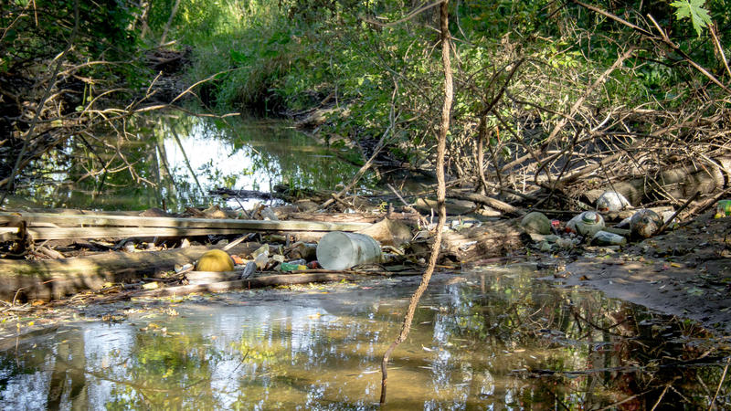 Portions of the Macatawa River behind the plant site were clogged with garbage before cleanup began.
