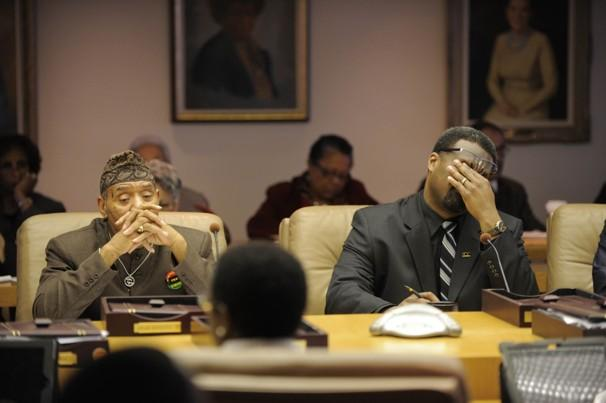 Detroit Council members Kwame Kenyatta, left, and James Tate during a debate over the consent agreement