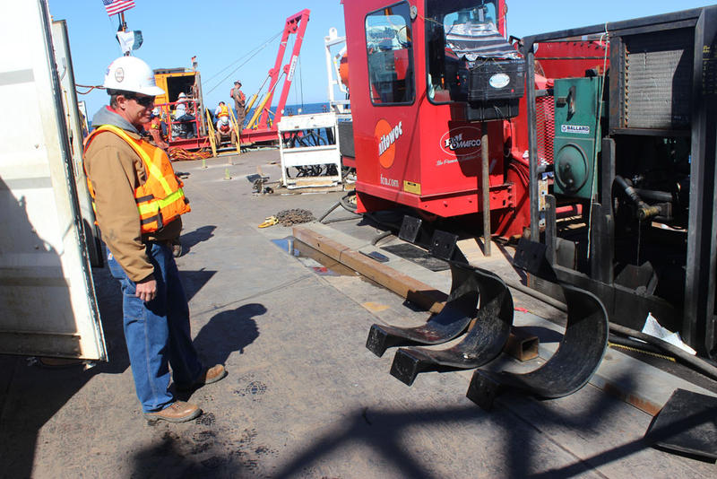 Tom Prew, a region engineer for Enbridge, on the deck of the work barge on the Straits of Mackinac. Brackets for the pipeline sit on the deck.