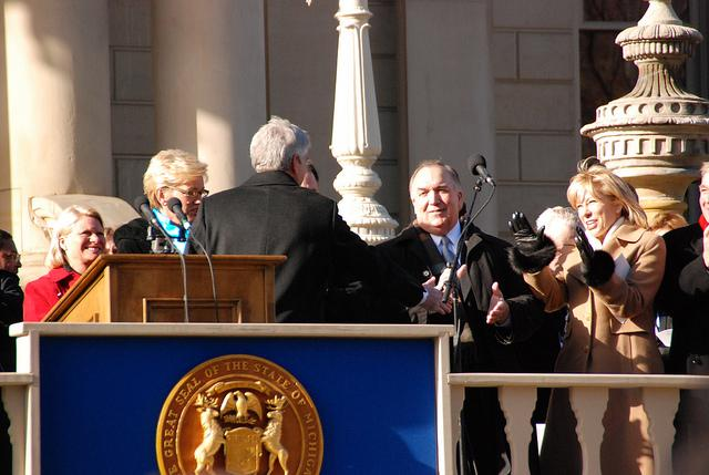 Former Governor John Engler (right) greets Governor Rick Snyder during his inauguration in 2011. Engler credit Snyder with improving Michigan tax code for businesses.