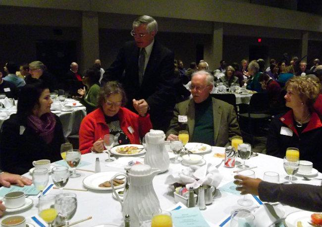 Mayor George Heartwell greets some of the hundreds of guests at his 10th annual state of the city address Saturday morning.