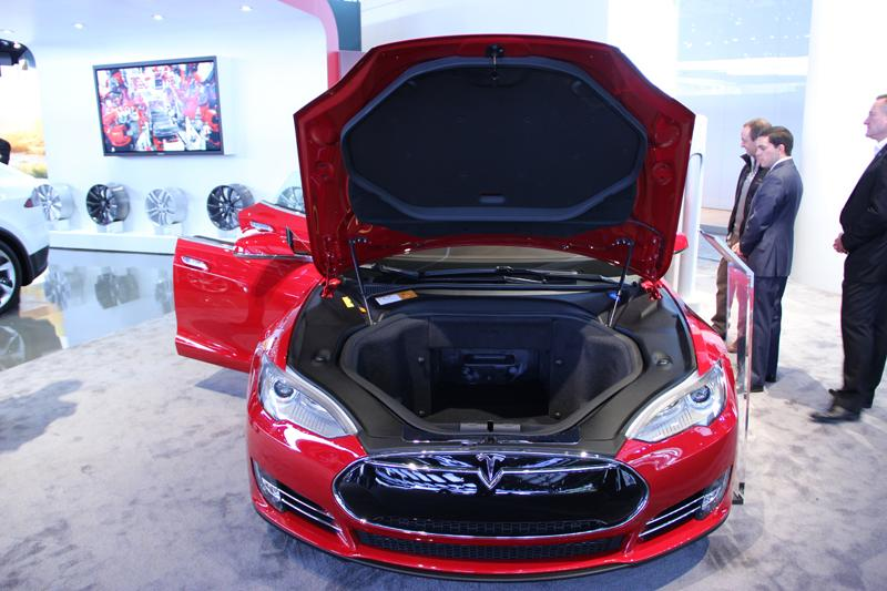 "Instead of an engine under the hood, the Tesla Model S has storage space. They call it a ""frunk."""