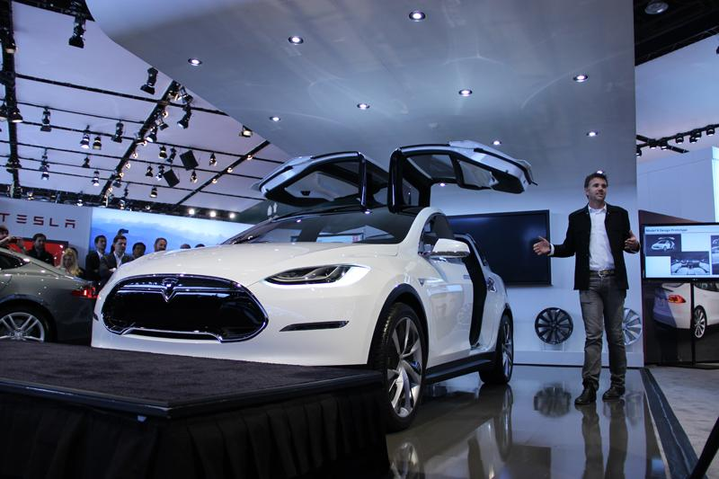 The Tesla Model X and its gull-wing doors.