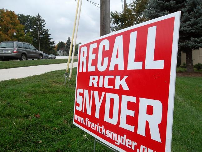 A yard sign from the unsuccessful first attempt to recall Gov. Rick Snyder