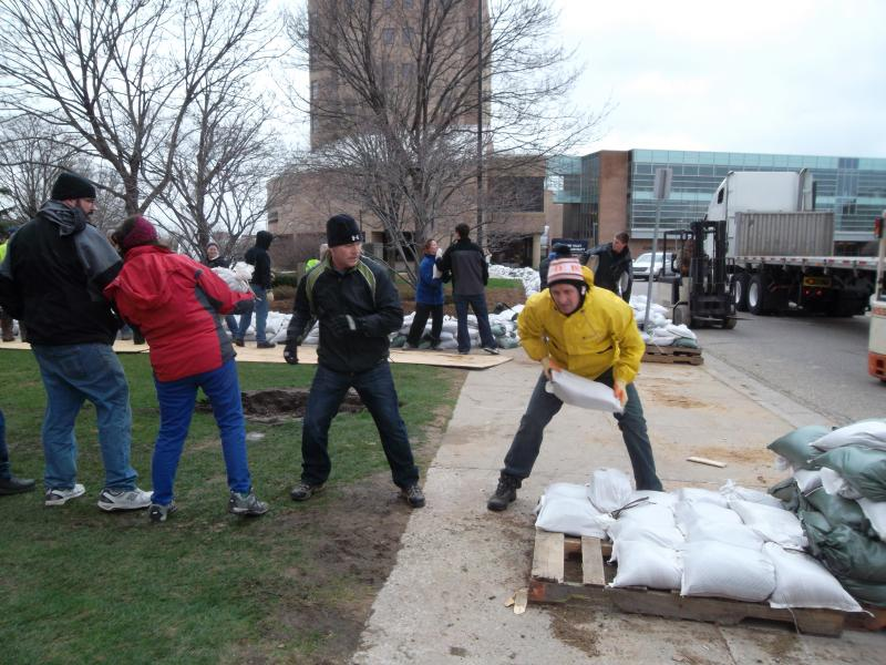 Sandbags are being deployed in downtown Grand Rapids to combat rising water from the Grand River.