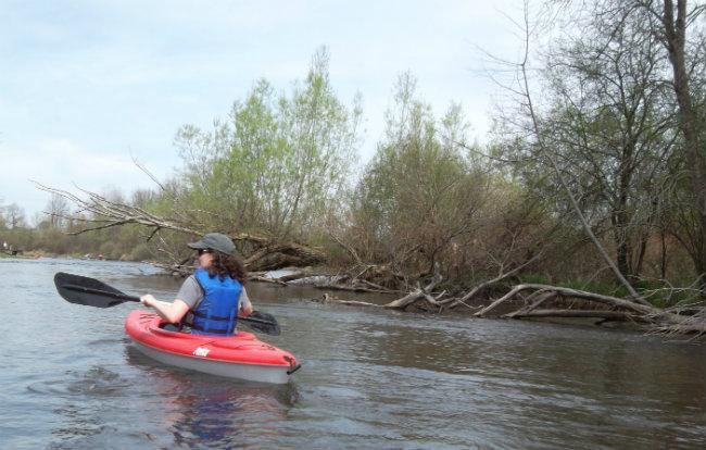 Journalists kayak down the Kalamazoo River upstream of the Ceresco Dam; three miles downstream from the spill site in Talmadge Creek.