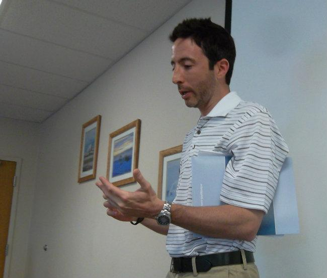 Enbridge spokesman Jason Manshum recounts facts from the 2010 oil spill at the company's headquarters in Marshall.