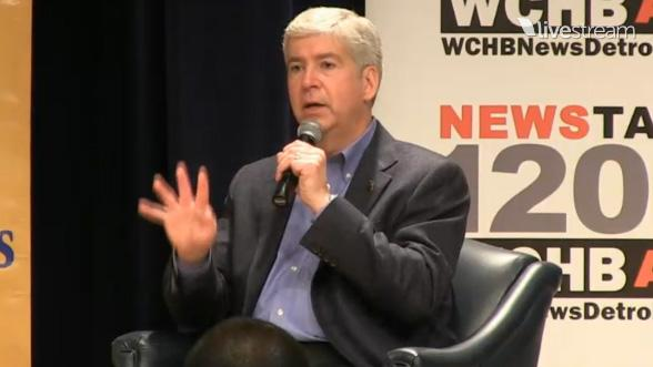 Michigan Governor Rick Snyder answering questions at a town hall meeting held at the Wayne County Community College in Detroit.