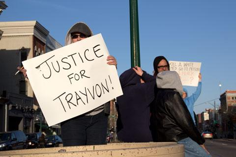 "Heather Mapstone holds the sign ""Justice for Trayvon,"" at a rally on March 26 in Ypsilanti."