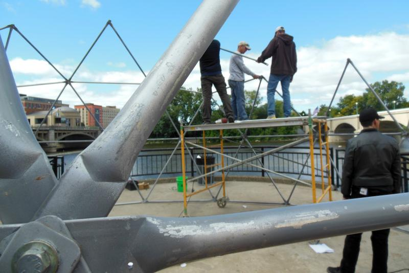 Kim Toogood's crew works to set up the framework for her geodesic dome. It'll be 25 feet in diameter and 15 feet high.