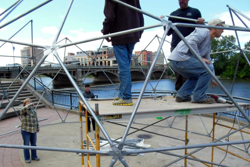 im Toogood watches her crew assemble about 200 steel beams in the shape of a geodesic dome.