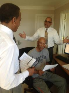 Mayor Bing (center) meets with Deputy Mayor Kirk Lewis (rear) and Communications Director Robert Warfield (foreground).