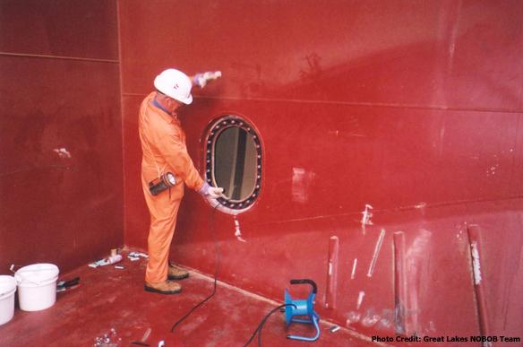 Entry to a ballast tank in a ship's cargo hold