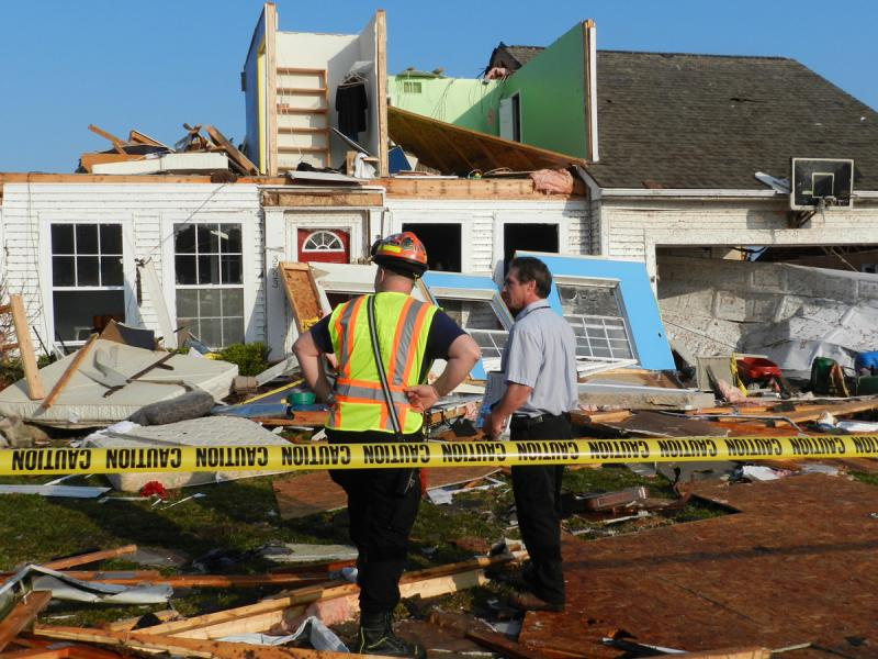 Repairing homes damaged by an F3 tornado in Dexter, Michigan.