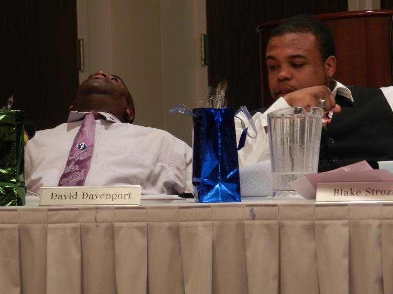 Flint Board of Education members David Davenport and Blake Strozier react as the debate over school closings hit another snag