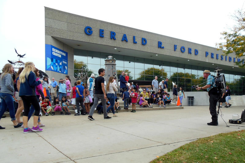 Thousands of tourists swarm the grounds near the Ford Museum Tuesday in Grand Rapids.
