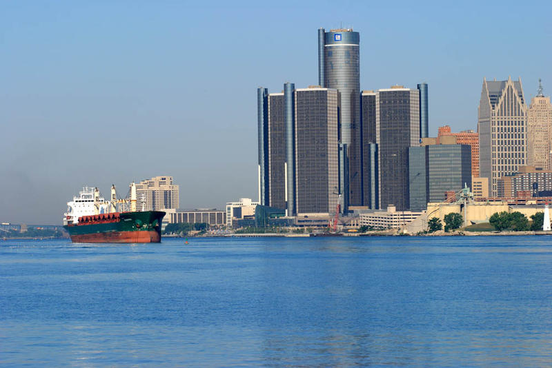 Freighter on the Detroit River with GM headquarters in background