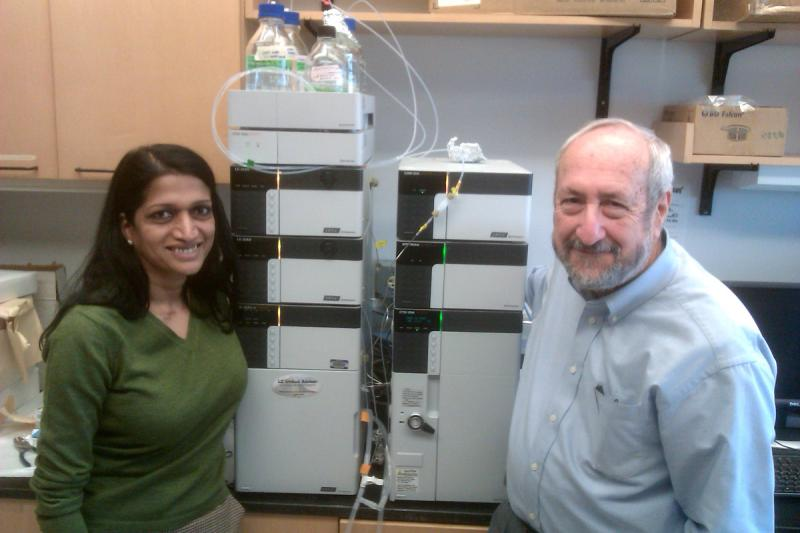 Dr. Madhuri Kakarala and Dr. Dean Brenner of the University of Michigan's Comprehensive Cancer Center. They're standing next to an ultra low flow liquid chromatography machine. It analyzes blood samples from people taking part in their studies.