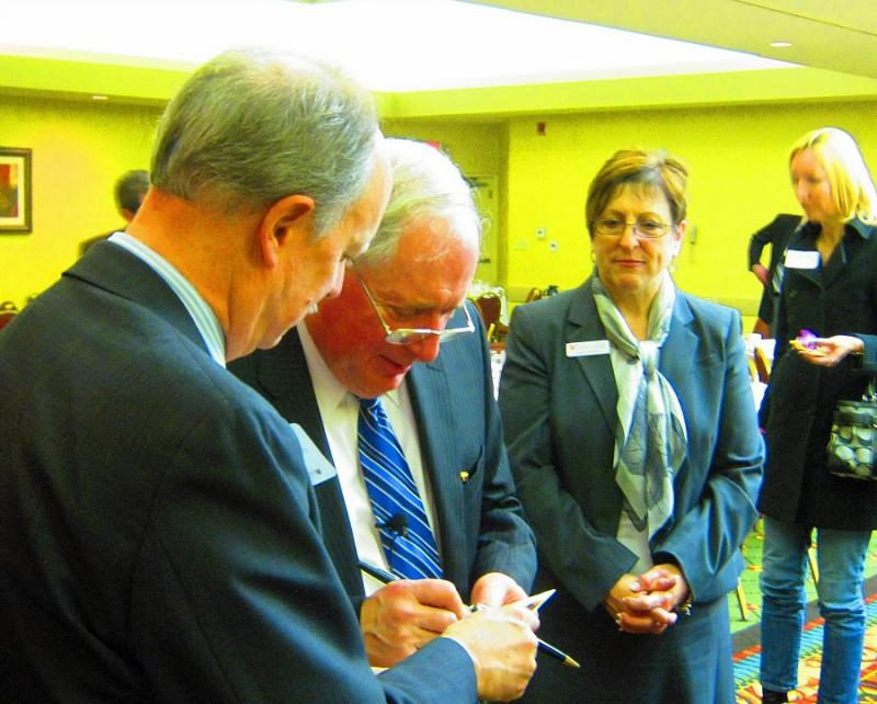 Senator Carl Levin speaks with guests at the Holland-Zeeland Chamber luncheon Monday.
