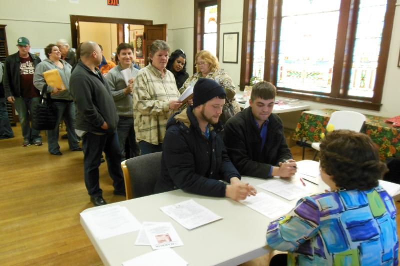 Couples wait in line for marriage applications in Muskegon County.