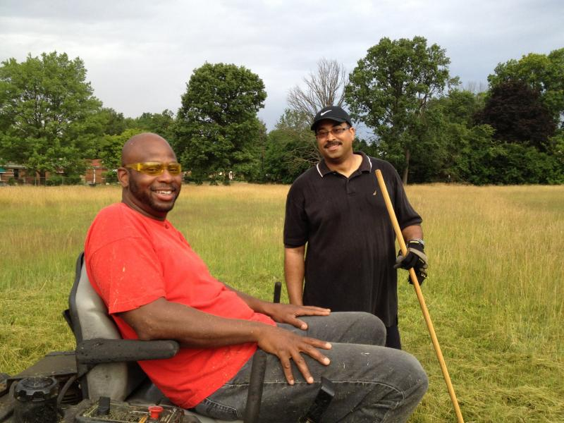 Detroit Mower Gang volunteers, Lucas and Dwayne.