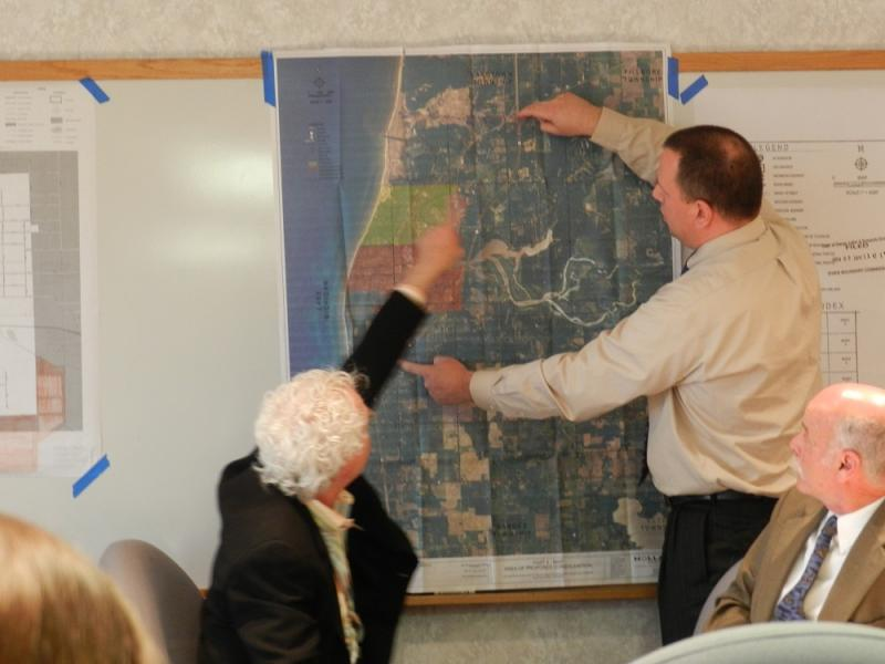Members of the Michigan State Boundary Commission review a map of Saugatuck, Douglas and Saugatuck Township