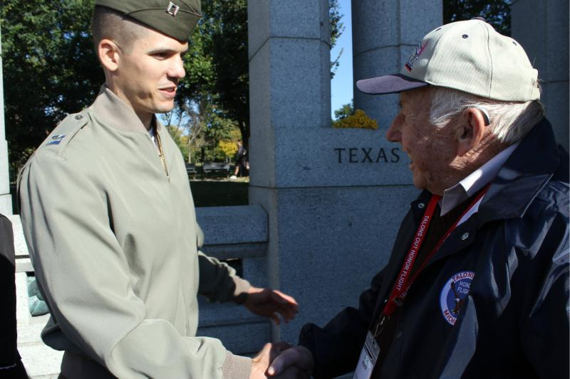 People thank veteran Dick Norr at the WWII memorial in Washington D.C.