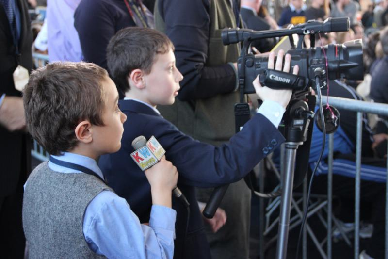 Cub reporters covering the president's speech.