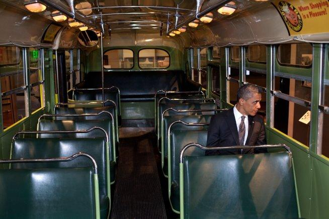 President Obama sits on the 'Rosa Parks bus' at the Henry Ford Museum following a fundraising event in Dearborn, Michigan.