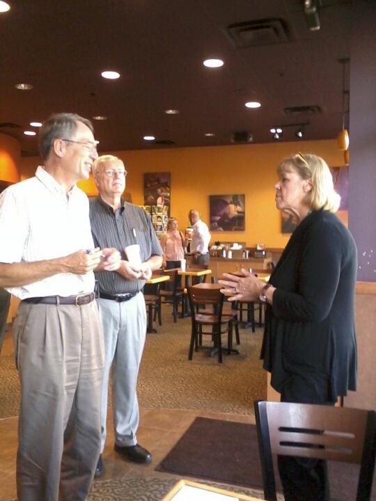 Rina Miller talks with people at Michigan Radio's #opennewsroom event at the Kalamazoo Biggby Coffee.