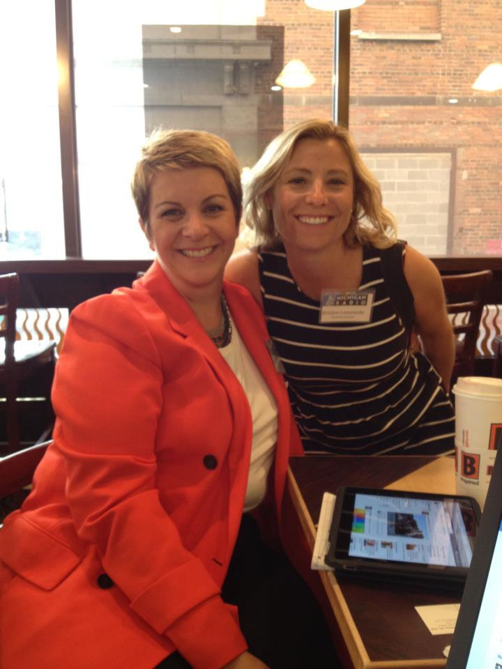 Kristen Loszewski and Cyndy Canty at Biggby Coffe in Lansing during the open news room event.