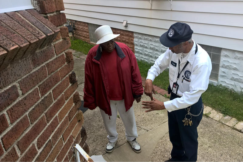DWSD's Terry Craig talks to Elaine Houston about the water pipe coming into her home.