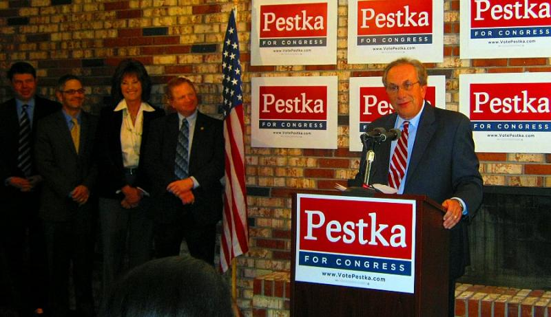 Steve Pestka was accompanied by (left to right) State Rep. Brandon Dillon, Former Congressman Mark Schauer, Pestka's wife Alicia, and State Rep. Roy Schmidt.