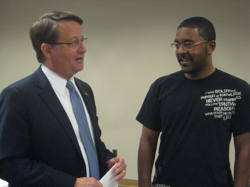 Michigan U.S. Rep. Gary Peters talks with Wayne State University student Norman Dotson about student loan interest rates.