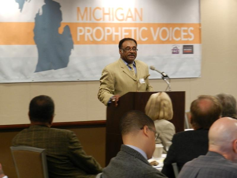Rev. Ira Edwards addresses other Michigan clergymen and women during a recent meeting in Lansing