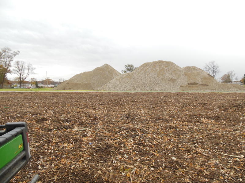 These large piles of broken-up concrete from old homes and a couple of businesses will be used to help build the new plant.