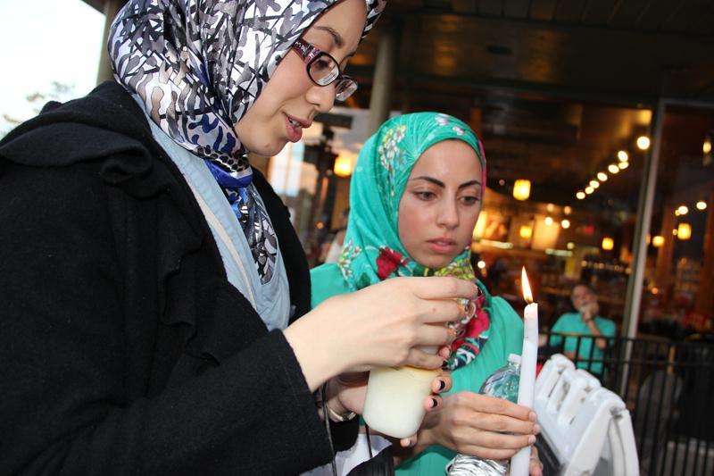 Muslims hold a vigil in Royal Oak in response to attacks in Libya.