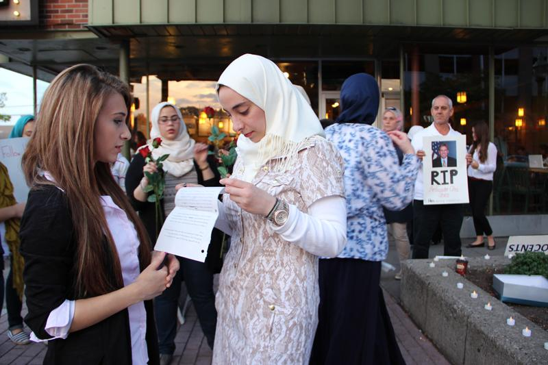 Muslims hold a vigil in Royal Oak in response to attacks in Libya.